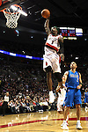 04/03/11--Blazers' Gerald Wallace flies towards the basket for a dunk as Mavericks' guard Jason Kidd watches in the second half at the Rose Garden in Portland, Or.. Portland defeated Dallas 104-96.Photo by Jaime Valdez.........................................