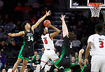 SIOUX FALLS, SD - MARCH 8: Stanley Umude #0 of the South Dakota Coyotes goes up for a jump shot against Filip Rebraca #12 of the North Dakota Fighting Hawks at the 2020 Summit League Basketball Championship in Sioux Falls, SD. (Photo by Richard Carlson/Inertia)