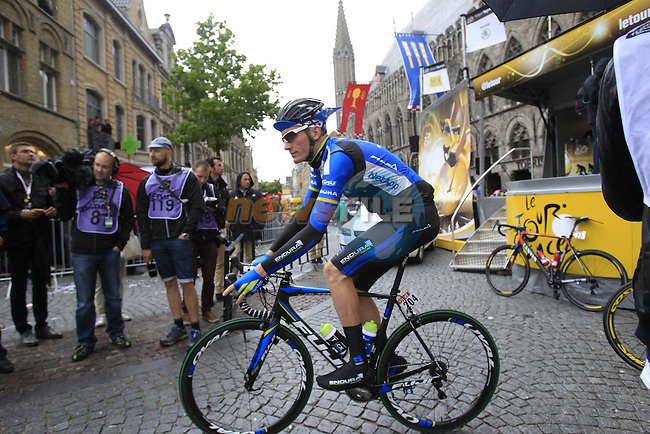 Zakkari Dempster (USA) Netapp-Endura at sign on in Ypres before the start of the cobbled stage Stage 5 of the 2014 Tour de France running 155.5km from Ypres to Arenberg. 9th July 2014.<br /> Picture: Eoin Clarke www.newsfile.ie
