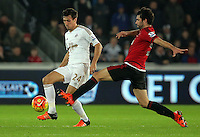 L-R Jack Cork of Swansea is tackled by Claudio Yacob of West Bromwich Albion during the Barclays Premier League match between Swansea City and West Bromwich Albion played at the Liberty Stadium, Swansea on December 26 2015