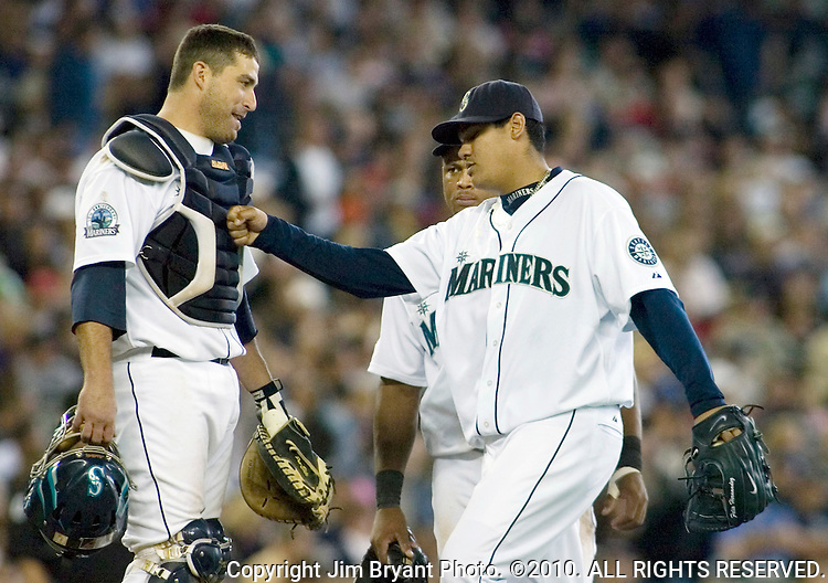 Seattle Mariners' starting pitcher Felix Hernandez, right, punches catcher Jamie Burke in the chest before being relieved in the seventh inning of their baseball game against the Chicago White Sox Sunday, Aug. 19, 2007 in Seattle. Hernandez struck out five batters and gave up five runs in the Mariners 11-5 win over the Sox. Behind Hernandez is third baseman Adrian Beltre. Jim Bryant Photo. ©2010. ALL RIGHTS RESERVED.