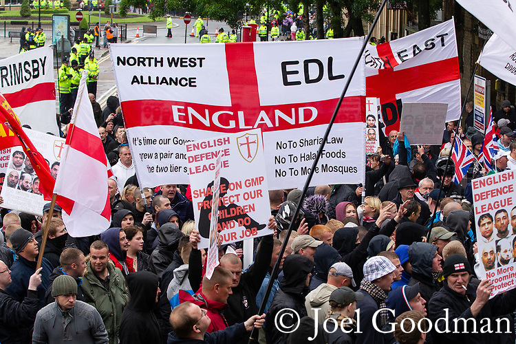 © Joel Goodman - 07973 332324 . 09/06/2012. Rochdale , UK. EDL supporters outside Rochdale Town Hall . The English Defence League ( EDL ) hold a march and rally in Rochdale Town Centre . Photo credit : Joel Goodman