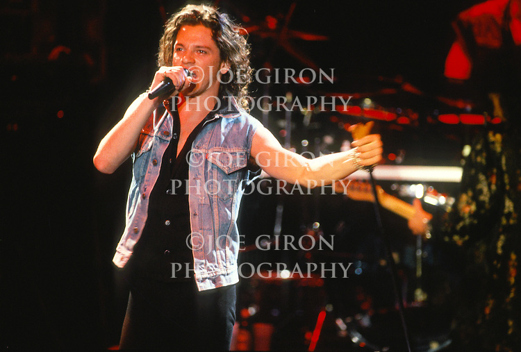 Various live photographs of the rock band, INXS