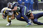 Pittsburgh Steelers tight end Heath Miller (83) is tackled by Seattle Seahawks linebackers K.J. Wright (50) and Bobby Wagner (54) at CenturyLink Field in Seattle, Washington on November 29, 2015.  The Seahawks beat the Steelers 39-30.      ©2015. Jim Bryant Photo. All Rights Reserved.