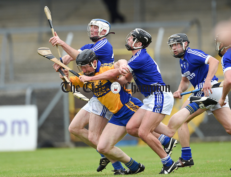 Niall Gilligan of Sixmilebridge in action against Barry Duggan and Liam Markham of Cratloe during their game in Cusack Park. Photograph by John Kelly.