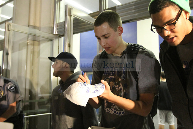 Kyle Wiltjer and Willie Cauley-Stein take time to sign autographs for UK fans during Big Blue Madness camp out on Thursday, Sept. 20, 2012. Photo by Kirsten Holliday | Staff