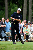 ary Wilcox/Staff.... 05/12/07...Phil Mickelson watches a fairway shot to the 18th green during the second round of play at The Players Championship on Friday. (05/11/07)