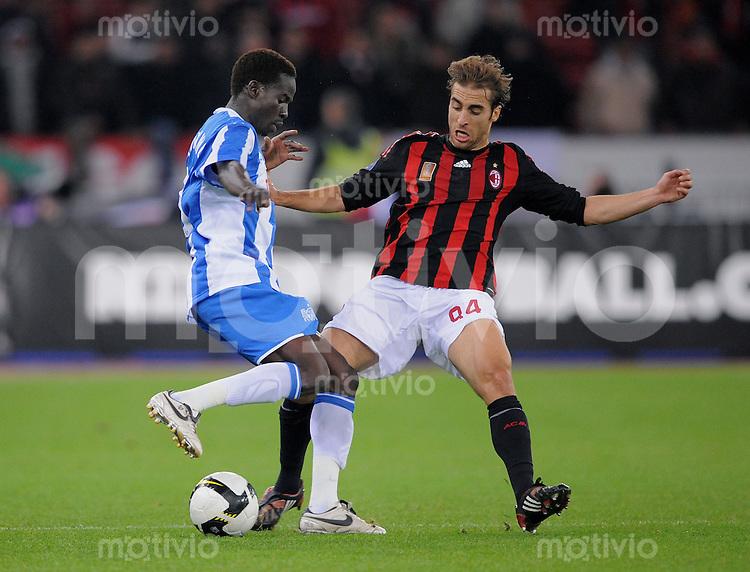 Fussball  UEFA Cup  1. Runde   2008/2009   18.09.2008 AC Mailand - FC Zuerich Mathieu Falmini (li, Mailand) gegen Onyekachi Okonkwo  (Zueri)