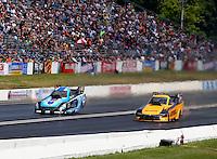 Jun 7, 2015; Englishtown, NJ, USA; NHRA funny car driver Jeff Diehl (left) races alongside Del Worsham during the Summernationals at Old Bridge Township Raceway Park. Mandatory Credit: Mark J. Rebilas-