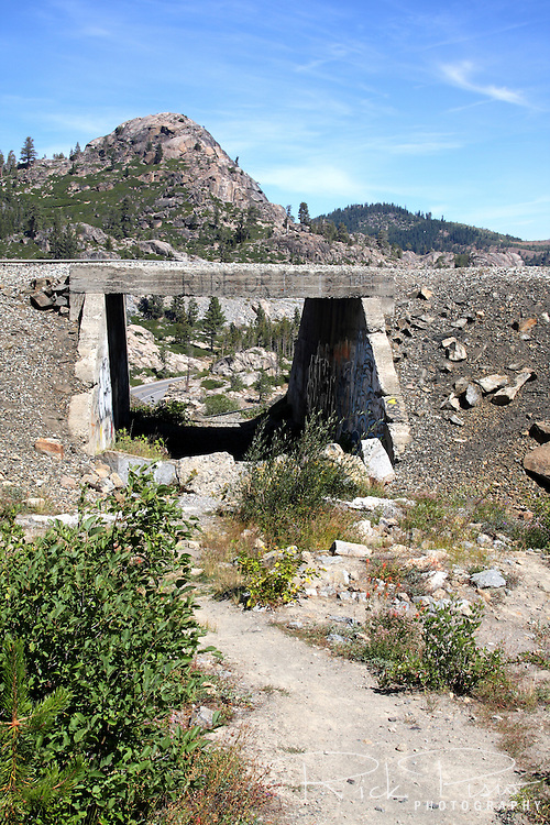Lincoln Highway viaduct passes under the Transcontinental Railroad railbed at Donner Summit, west of Truckee, California. Historic Highway 40 is visible through the viaduct.
