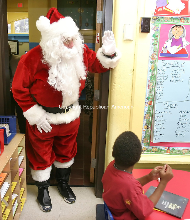 WATERBURY, CT. 21 December 2007-122107SV11--Santa visited students at Woodrow Wilson School to pass out gifts in Waterbury. The local company from Beacon Falls, NEJ Inc., gave every student at the School a gift Friday.<br /> Steven Valenti Republican-American