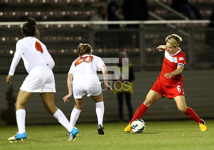 BOYDS, MARYLAND - April 06, 2013:  Lori Lindsey (6) of The Washington Spirit  controls the ball in front of Campbell Millar (20) of the University of Virginia women's soccer team in a NWSL (National Women's Soccer League) pre season exhibition game at Maryland Soccerplex in Boyds, Maryland on April 06. Virginia won 6-3.