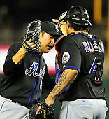 New York Mets pitcher Hisanori Takahashi (47), left, and catcher Henry Blanco (4) celebrate their team's 4 -1 victory over the Washington Nationals at Nationals Park in Washington, D.C. on Tuesday, September 7, 2010. .Credit: Ron Sachs / CNP.(RESTRICTION: NO New York or New Jersey Newspapers or newspapers within a 75 mile radius of New York City)
