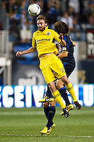 Eddie Gaven (12) of the Columbus Crew and Gabriel Farfan (15) of the Philadelphia Union. The Columbus Crew defeated the Philadelphia Union 2-1 during a Major League Soccer (MLS) match at PPL Park in Chester, PA, on August 29, 2012.