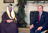 United States President George W. Bush meets with President Ghazi al-Yawer of Iraq during their meeting in the Oval Office of the White House in Washington, D.C. on December 6, 2004.<br /> Credit: Ron Sachs / CNP