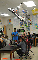 NWA Democrat-Gazette/FLIP PUTTHOFF <br /> Ryan Quintana,  world history and science teacher at Lingle Middle School, starts a science class Friday Sept. 23 2016 at the school in Rogers.