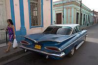 blue oldtimer in street scene in Santa Clara, Cuba