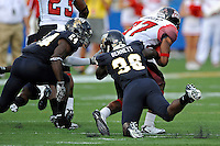 24 September 2011:  FIU running back Brandon Bennett (36), with defensive back Emmanuel Souarin (24) in pursuit, attempts to end a kick return by ULL wide receiver Darryl Surgent (87) in the first quarter as the University of Louisiana-Lafayette Ragin Cajuns defeated the FIU Golden Panthers, 36-31, at FIU Stadium in Miami, Florida.