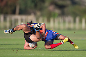 Ray Laulala throws Sonatane Halaeko to ground. Counties Manukau Premier Club Rugby game between Ardmore Marist and Weymouth, played at Bruce Pulman Park on May 14th 2016. Ardmore Marist won the game 43 - 7 after leading 17 - 0 at halftime. Photo by Richard Spranger.