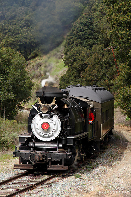 The Robert Dollar Co. steam engine #3 pulls a passenger train through Sunol Canyon. Built in 1927 by the American Locomotive Company (ALCO) the #3 remained in service with the Robert Dollar Lumber Co. until 1959. In February of 2007 its rebuild was completed and it began pulling passengers through Niles Canyon.