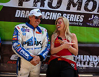 Jun 17, 2018; Bristol, TN, USA; NHRA funny car driver John Force (left) talks with daughter Courtney Force during the Thunder Valley Nationals at Bristol Dragway. Mandatory Credit: Mark J. Rebilas-USA TODAY Sports