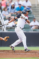 Tyler Williams (6) of the Kannapolis Intimidators follows through on his swing against the Savannah Sand Gnats at CMC-Northeast Stadium on June 9, 2014 in Kannapolis, North Carolina.  The Intimidators defeated the Sand Gnats 4-2.  (Brian Westerholt/Four Seam Images)