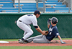 March 30, 2012:   BYU Cougars runner Tanner Chauncey is tagged out by the Nevada Wolf Pack third baseman Ryan Teel but Chauncey was awarded the base due to baserunner interference on the shortstop during their NCAA baseball game played at Peccole Park on Friday afternoon in Reno, Nevada.