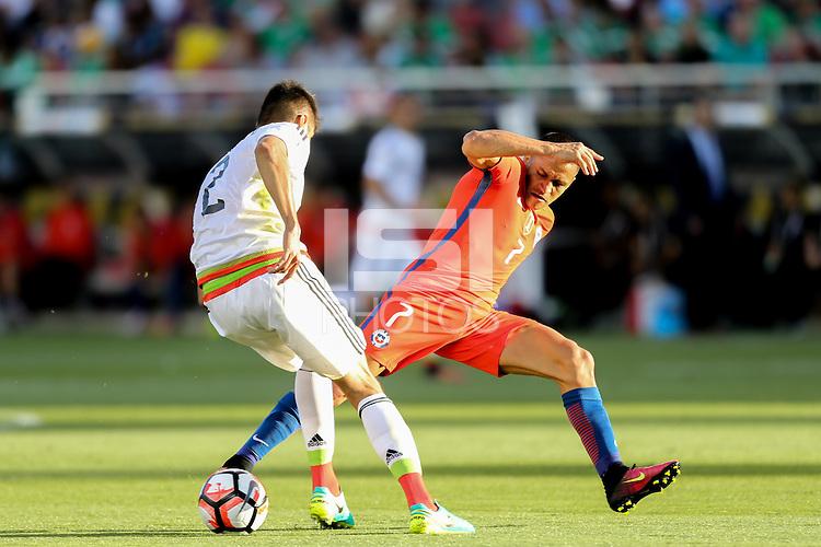 Santa Clara, CA - Saturday June 18, 2016: Alexis Sanchez, Nestor Araujo during a Copa America Centenario quarterfinal match between Mexico (MEX) and Chile (CHI) at Levi's Stadium.