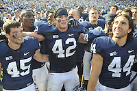 06 October 2012:  Penn State's P.J. Byers or Alex Butterworth(45), Michael Mauti (42), and Michael Fuhrman (44) sing the Penn State alma mater with the student section after the win.  The Penn State Nittany Lions defeated the Northwestern Wildcats 39-28 at Beaver Stadium in State College, PA.