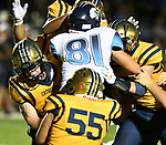 Mater Dei's Ben Kassen (center) is smothered by Althoff players as they tackle him. Mater Dei played football at Althoff on Friday September 13, 2019. <br /> Tim Vizer/Special to STLhighschoolsports.com