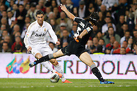 08.04.2012 SPAIN -  La Liga matchday 32th  match played between Real Madrid CF vs Valencia (0-0) and falls to 4 points behind Barcelona, at Santiago Bernabeu stadium. The picture show Cristiano Ronaldo (Portuguese forward of Real Madrid) and Mehmet Topal (Midfielder of Valencia)