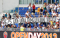 "Calcio: allenamento a porte aperte ""Open Day"" per la presentazione della Roma, a Roma, stadio Olimpico, 21 agosto 2013.<br /> AS Roma fans hold a banner reading ""26/5 We don't forget... Shame"", referring to the Italy Cup final match lost agains Lazio's city rivals, on last 26 May, during the AS Roma football club's Open Day training session at Rome's Olympic stadium, 21 August 2013.<br /> UPDATE IMAGES PRESS/Riccardo De Luca"
