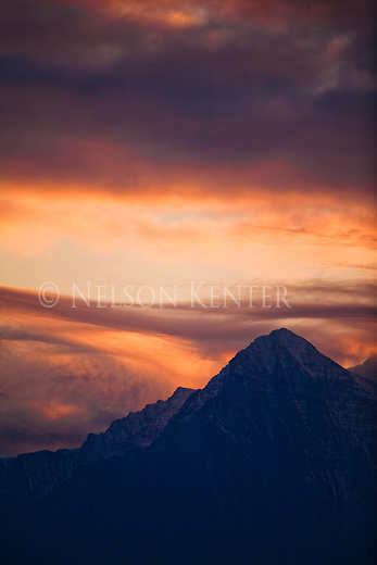 Clouds and colorful sky at sunrise over the Mission Mountains in Big Sky Country