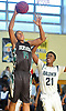 Zed Key #14 of Brentwood, left, drives to the net during the second half of a non-league varsity boys basketball game against Baldwin in the Richard Brown Nassau-Suffolk Challenge at Uniondale High School on Saturday, Jan. 13, 2018.