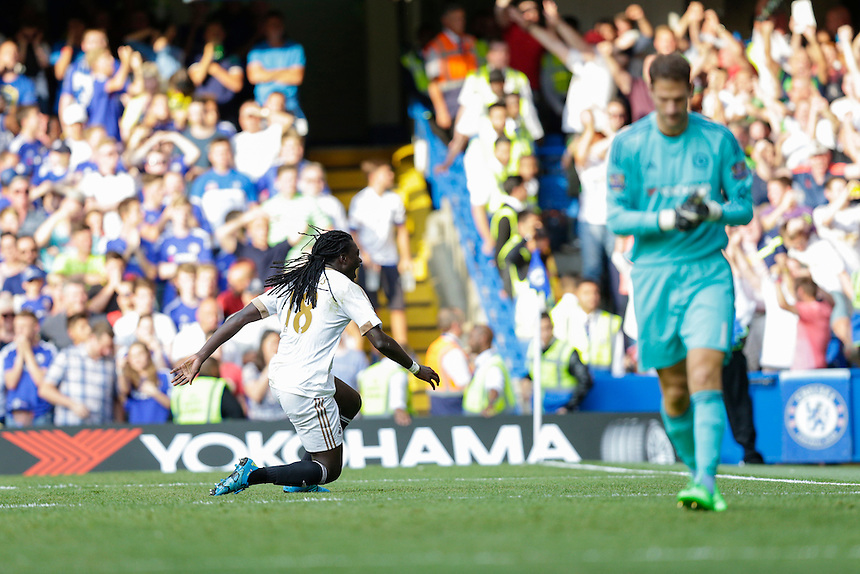 Swansea City's Bafetibis Gomis celebrates scoring his sides second goal <br /> <br /> Photographer Craig Mercer/CameraSport<br /> <br /> Football - Barclays Premiership - Chelsea v Swansea City - Saturday 8th August 2015 - Stamford Bridge - London<br /> <br /> &copy; CameraSport - 43 Linden Ave. Countesthorpe. Leicester. England. LE8 5PG - Tel: +44 (0) 116 277 4147 - admin@camerasport.com - www.camerasport.com