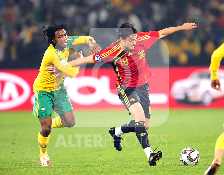 Macbeth Sabaya and Albert Riera  during the soccer match of the 2009 Confederations Cup between Spain and South Africa played at the Freestate Stadium,Bloemfontein,South Africa on 20 June 2009.  Photo: Gerhard Steenkamp/Superimage Media.