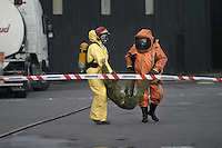 Disaster exercise in Oslo, with a scenario of a chemical tanker colliding with a bus. Rescue personnel wearing protective gear.