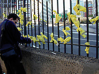 Messages of hope are tied to a fence in New York City days after the Sept. 11th attack on The World Trade Center.