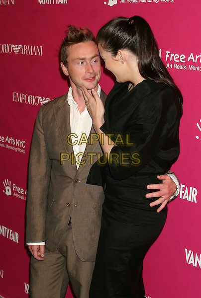ROYSTON LANGDON & LIV TYLER.The 7th annual Free Arts NYC Art + Photography benefit auction at Phillips de Pury, New York, New York, USA..May 23rd, 2006.Ref: IW.half length married husband wife black skirt jacket brown suit touching face.www.capitalpictures.com.sales@capitalpictures.com.©Capital Pictures
