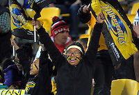 Fans celebrate Ngani Laumepe's try during the Super Rugby match between the Hurricanes and Southern Kings at Westpac Stadium, Wellington, New Zealand on Friday, 25 March 2016. Photo: Dave Lintott / lintottphoto.co.nz