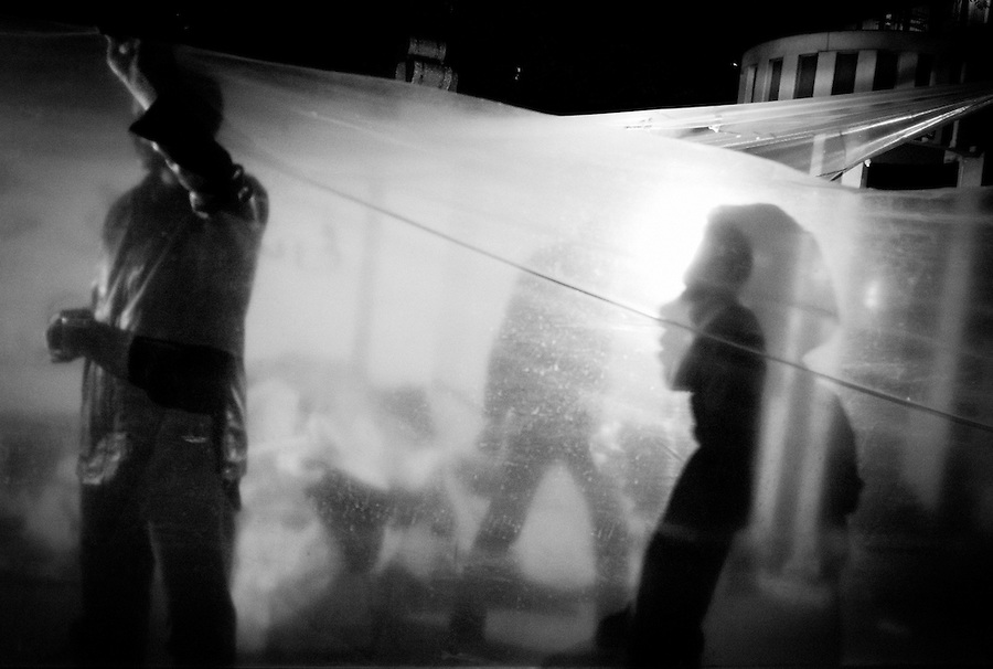 Shadows and silhouettes of protestors behind plastic sheeting across from the Egyptian Parliament building in Cairo, Egypt, Thursday, Dec. 1, 2011.