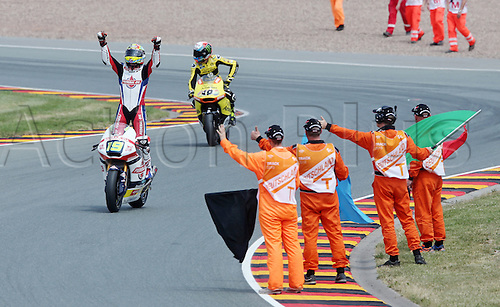 12.07.2015. Sachsenring, Germany MotoGP.  Moto2 Gopro Motorrad Grand Prix Germany.  Belgian Moto2 rider Xavier Simeon of Federal Oil Gresini Moto2 cheers after winning the Motorcycle World Championship Grand Prix of Germany at the Sachsenring racing circuit in Hohenstein-Ernstthal, Germany, 12 July.