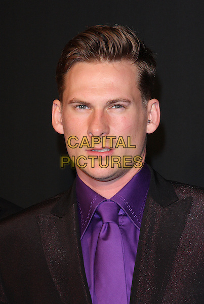 Lee Ryan of Blue.Grey Goose Winter Ball at the Battersea Evolution, London, England..29th October 2011.headshot portrait black purple tie looks angry upset.CAP/ROS.©Steve Ross/Capital Pictures..