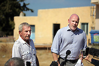 Pictured L-R: Eddie Needham the grandfather of missing Ben Needham with DI Jon Cousins of South Yorkshire Police read a brief statement outside the farmhouse where Ben disappeared from in Kos, Greece. Wednesday 05 October 2016<br />