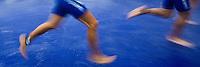 07 JUL 2012 - PARIS, FRA - Competitors run through the showers after the swim during the elite men's French Grand Prix round during the 2012 Triathlon de Paris at the Pont d'Lena, Paris, France .(PHOTO (C) 2012 NIGEL FARROW)