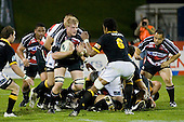 Andrew Van der Heijden braces as he is confronted by Api Naikatini. Air New Zealand Cup rugby game between Counties Manukau Steelers & Wellington played at Mt Smart Stadium on the 31st August 2007. The Score was 13 all at halftime, with Wellington going on to win 33 - 18.
