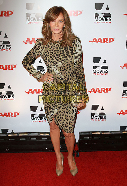 JACLYN SMITH.AARP The Magazine's 10th Annual Movies For Grownups Awards held At The Beverly Wilshire Hotel, Hollywood, California, USA..February 7th, 2011.full length black white beige leopard print dress shoes clutch bag hand on hip.CAP/ADM/KB.©Kevan Brooks/AdMedia/Capital Pictures.