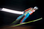 Skiers compete during the Ski Jumping Ladies' Normal Hill Individual as part of the 2014 Sochi Olympic Winter Games at RusSki Gorki Jumping Center on February 11, 2014 in Sochi, Russia. Photo by Victor Fraile / Power Sport Images
