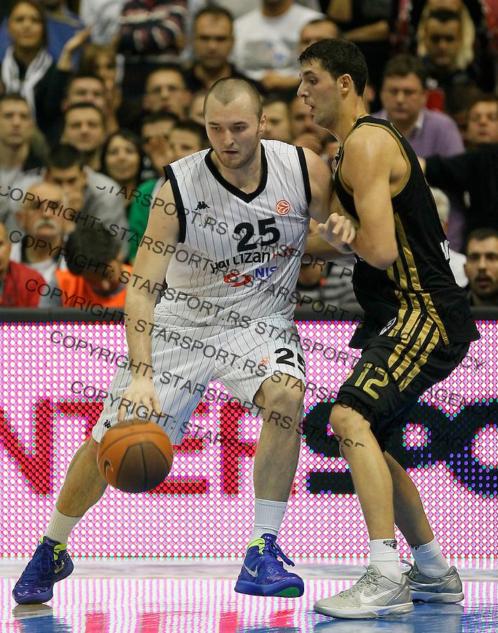 Kosarka, Euroleague, sezona 2011/2012.Partizan Vs. Real Madrid.milan Macvan, left and Nikola Mirotic.Belgrade, 10.11.2011..foto: Srdjan Stevanovic/Starsportphoto ©