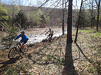 NWA Democrat-Gazette/FLIP PUTTHOFF <br /> Mountain biking is a top activity at Devil's Den State Park. Riders pedal along Lee Creek last April during the Ozark Mountain Bike Festival at the park.